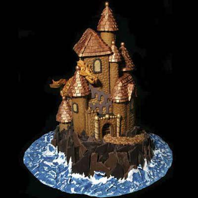 Gingerbread castle with detailed patterns on the towers and roof.