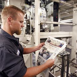 The Deseret News rolls off the presses Monday in West Valley City. Newspaper management assured readers that the paper will continue publication seven days a week well into the future.