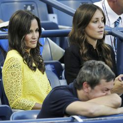 Pippa Middleton, left, the sister of Kate Middleton, the Duchess of Cambridge, sits with an unidentified woman at the 2012 US Open tennis tournament,  Wednesday, Sept. 5, 2012, in New York. (AP Photo/Charles Krupa)