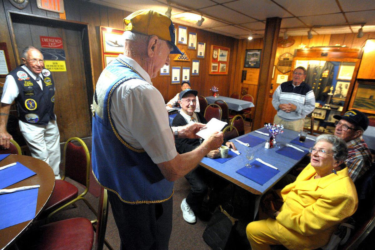 ADVANCE FOR SUNDAY SEPT. 23 - In this  Sept. 11, 2012 photo, Dean Brown the state commander for Connecticut of the Submarine Veterans of World War II tells members of the Thames River Chapter at the Subvets clubhouse in Groton, Conn., that the national or