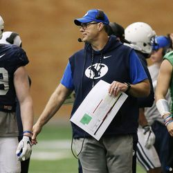 New Brigham Young Cougars offensive coordinator Jeff Grimes watches action during an intersquad scrimmage in Provo on Friday, March 23, 2018.