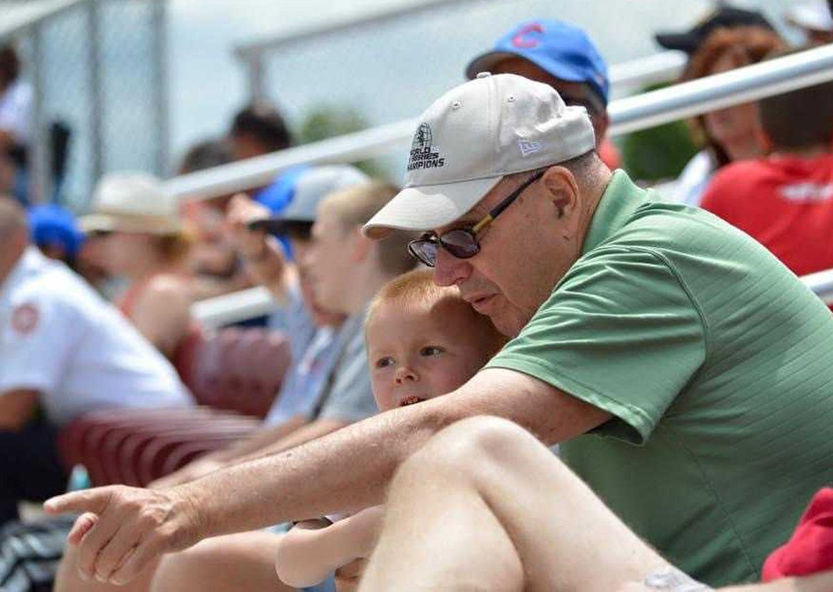 Richard Jaworowski in 2016 with his youngest grandson, Owen, teaching him about baseball at a high school game in Cedar Lake, Ind.