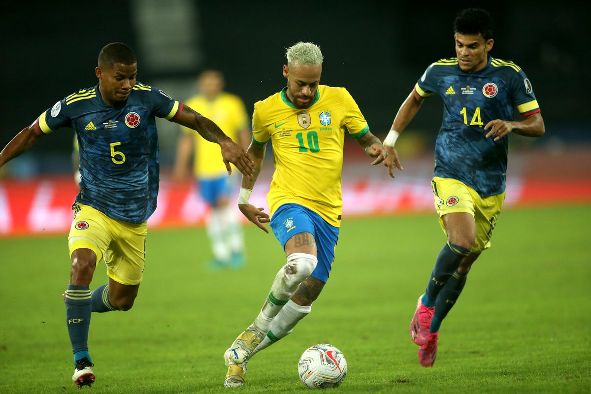 Neymar Jr of Brazil competes for the ball with Wilmar Barrios and Luis Diaz of Colombia during the match between Brazil and Colombia as part of Conmebol Copa America Brazil 2021 at Estadio Olímpico Nilton Santos on June 23, 2021 in Rio de Janeiro, Brazil.