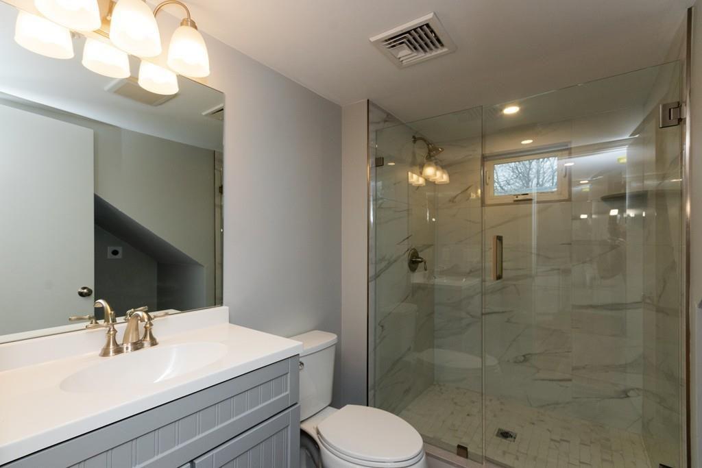 A bathroom with a glass-door shower.