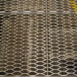 Underneath the grates, there's more fiberglass insulation