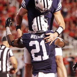 Brigham Young Cougars running back Jamaal Williams (21) celebrates his score with Brigham Young Cougars quarterback Taysom Hill (4)   in Salt Lake City  Sunday, Sept. 16, 2012.