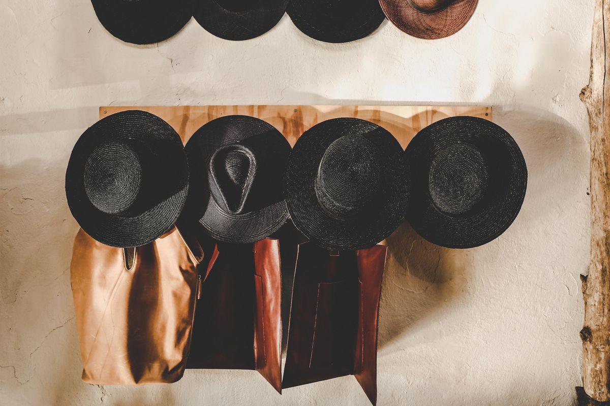 Hats on the wall at Na Nin
