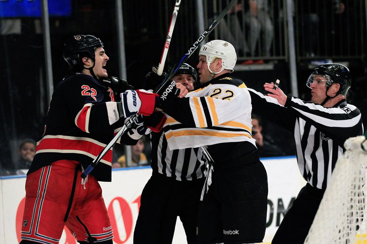 NEW YORK, NY - APRIL 01: Brian Boyle #22 of the New York Rangers and Shawn Thornton #22 of the Boston Bruins are restrained by referees at Madison Square Garden on April 1, 2012 in New York City.  (Photo by Chris Trotman/Getty Images)