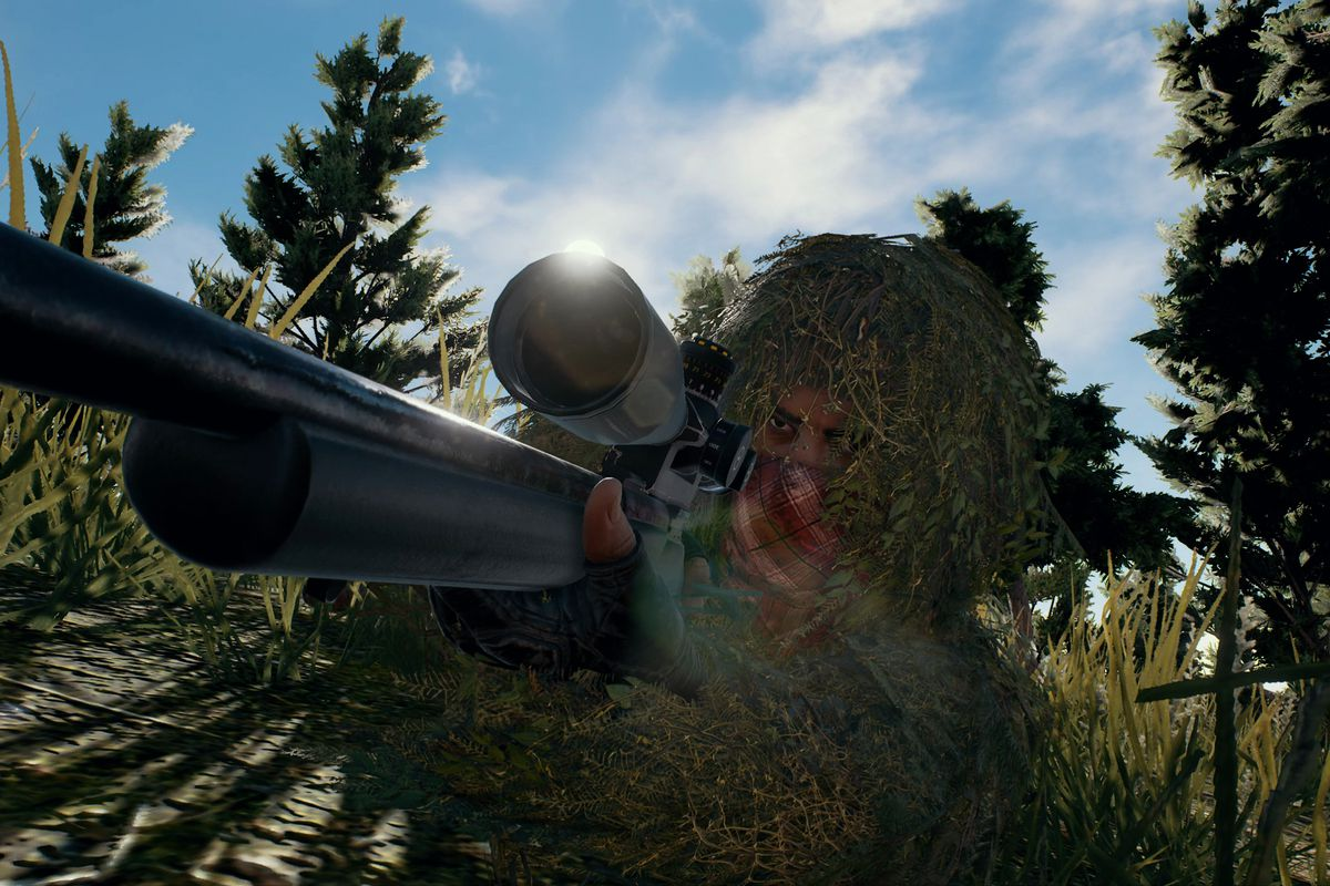 a dude crouching and taking cover in pubg