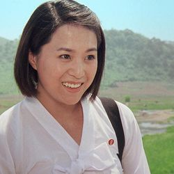 """In this image made out of film """"Comrade Kim Goes Flying"""" released by Another Dimension of An Idea/Koryo Group, Comrade Kim Yong Mi played by Han Jong Sim smiles in Korean dress.  It's a classic tale of a small town girl who follows her dreams to the big city. But in this case, the girl is a North Korean coal miner, the big city is Pyongyang and her dream is to become a high-flying trapeze artist. """"Comrade Kim Goes Flying,"""" a collaboration between a North Korean director and two European filmmakers, makes its world premiere Saturday, Sept. 8, 2012 at the Toronto International Film Festival before it heads to Pyongyang later this month for its North Korean debut."""