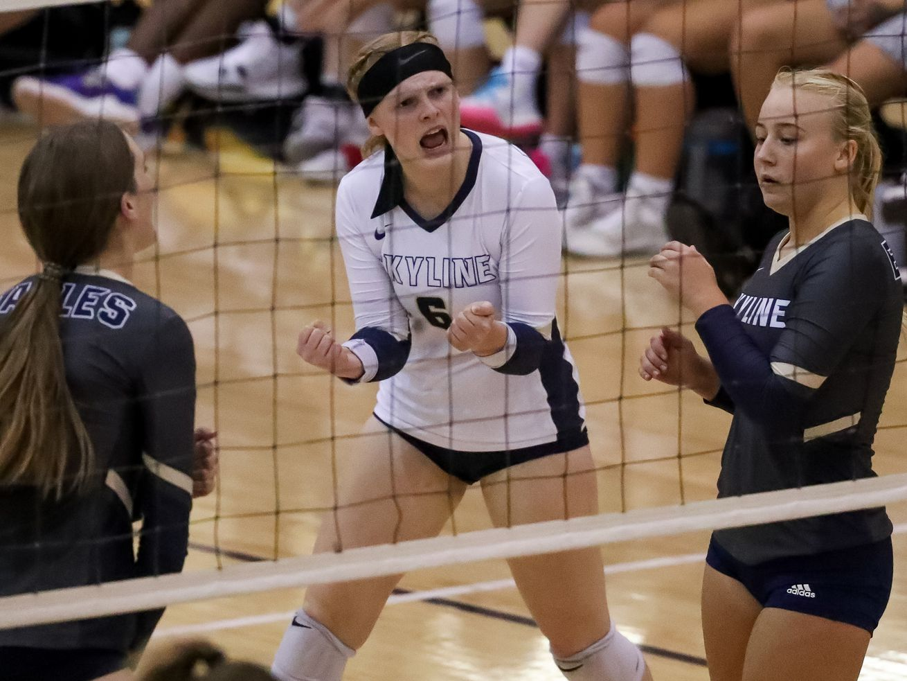 Skyline's Anna Rosse, wearing a white jersey, screams with teammates