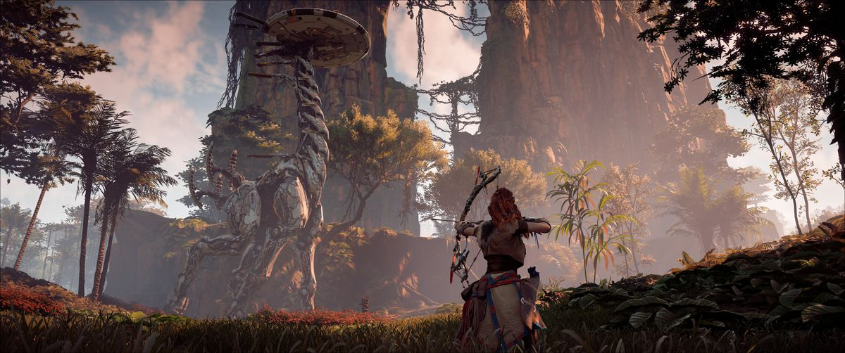 Aloy, a red-haired female warrior, aims a bow at a Tallneck, a giraffe-like robot, in Horizon Zero Dawn