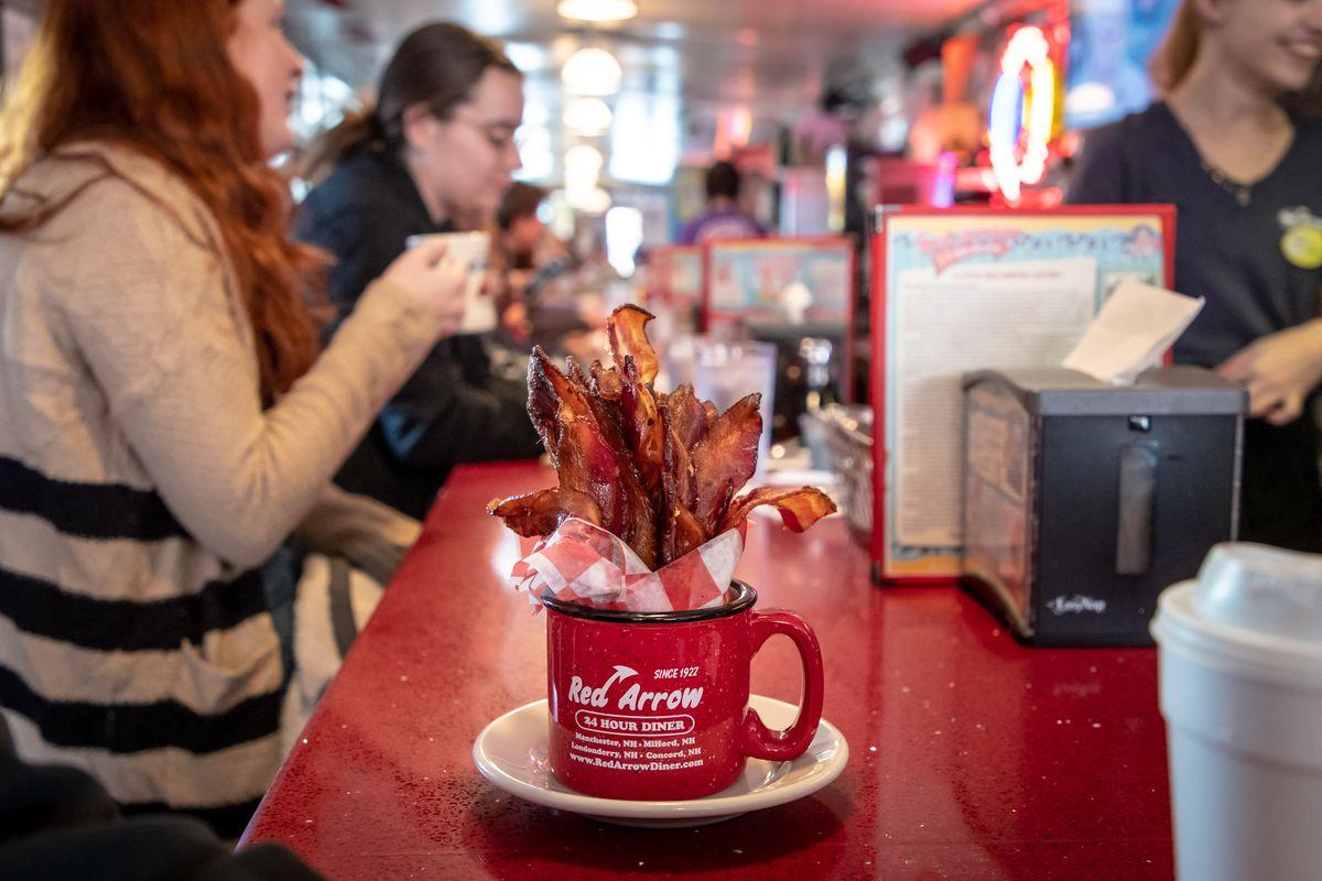 A mug with bacon strips