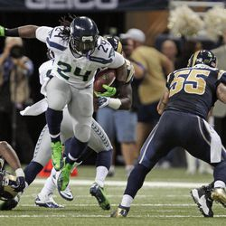 Seattle Seahawks running back Marshawn Lynch (24) runs against St. Louis Rams middle linebacker James Laurinaitis (55) during the first half of an NFL football game Sunday, Sept. 30, 2012, in St. Louis.