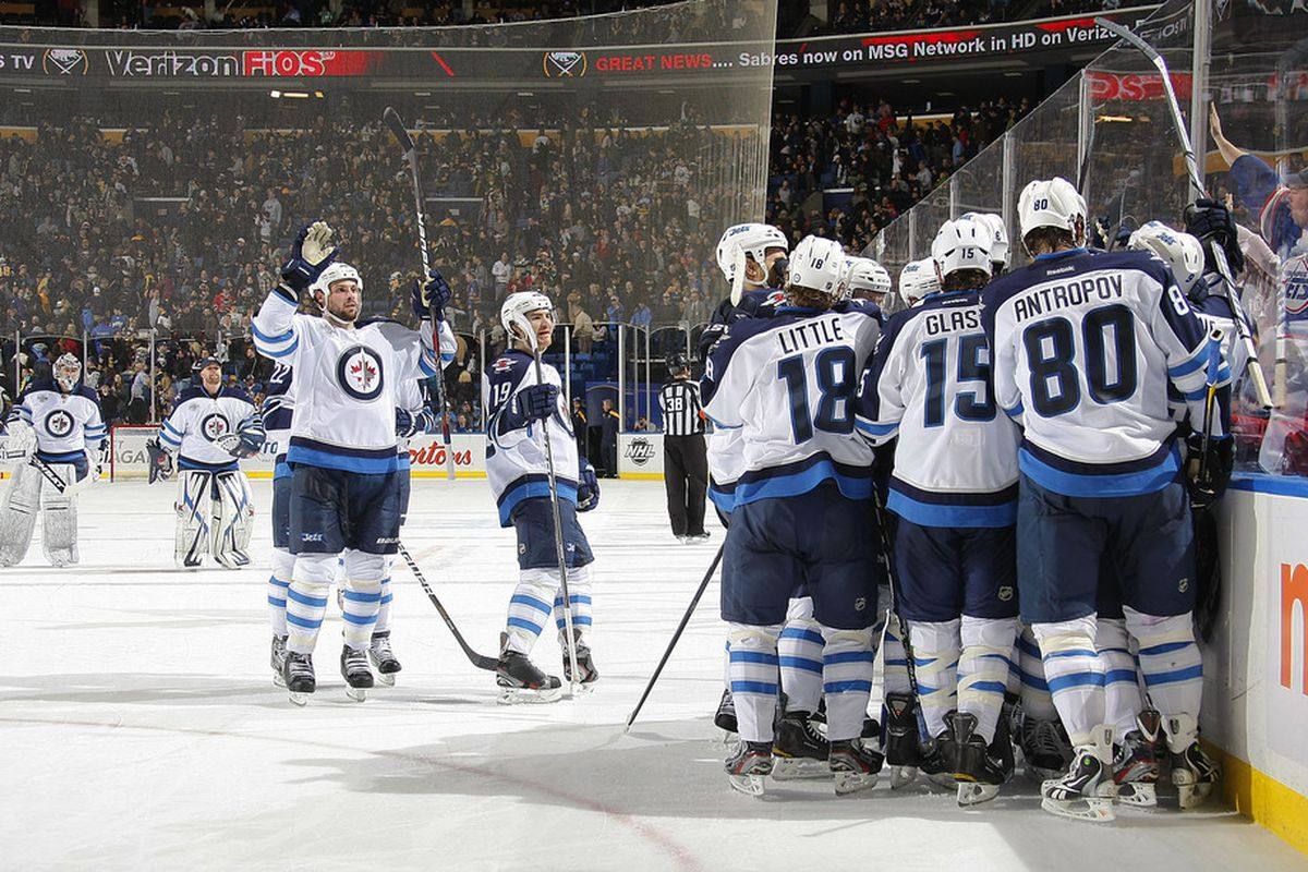 BUFFALO, NY - JANUARY 7:  Members of the Winnipeg Jets celebrate their overtime win over the Buffalo Sabres during their NHL game at First Niagara Center on January 7, 2012 in Buffalo, New York.  (Photo by Dave Sandford/Getty Images)