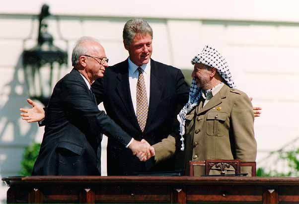 Former President William Clinton at at the Oslo Accords signing ceremony on September 13, 1993 with former Israeli Prime MinisterYitzhak Rabin, then Palestinian leaderYasser Arafat.