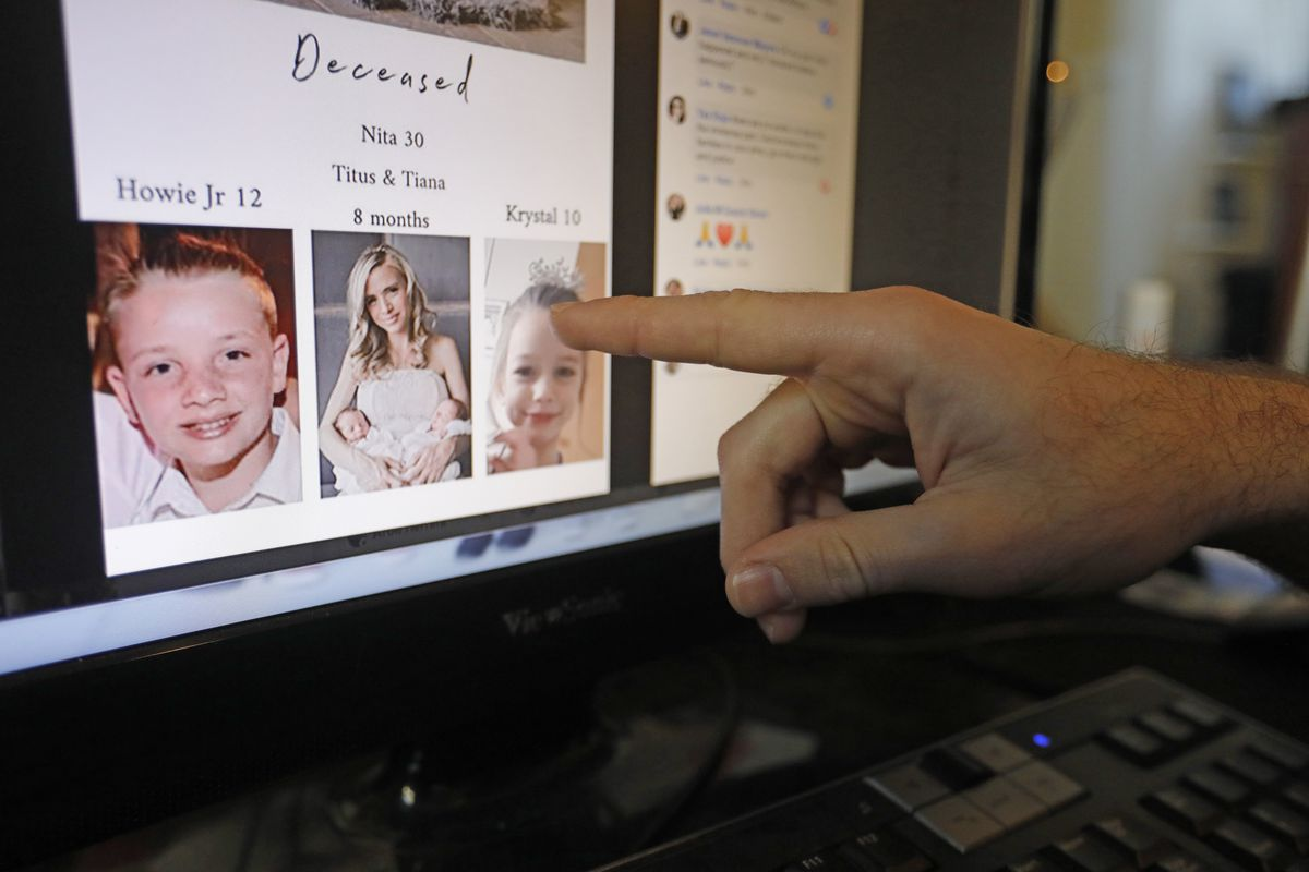 A man points to a photo of relatives Rhonita Miller and her family, who were killed in Mexico, on a computer screen.