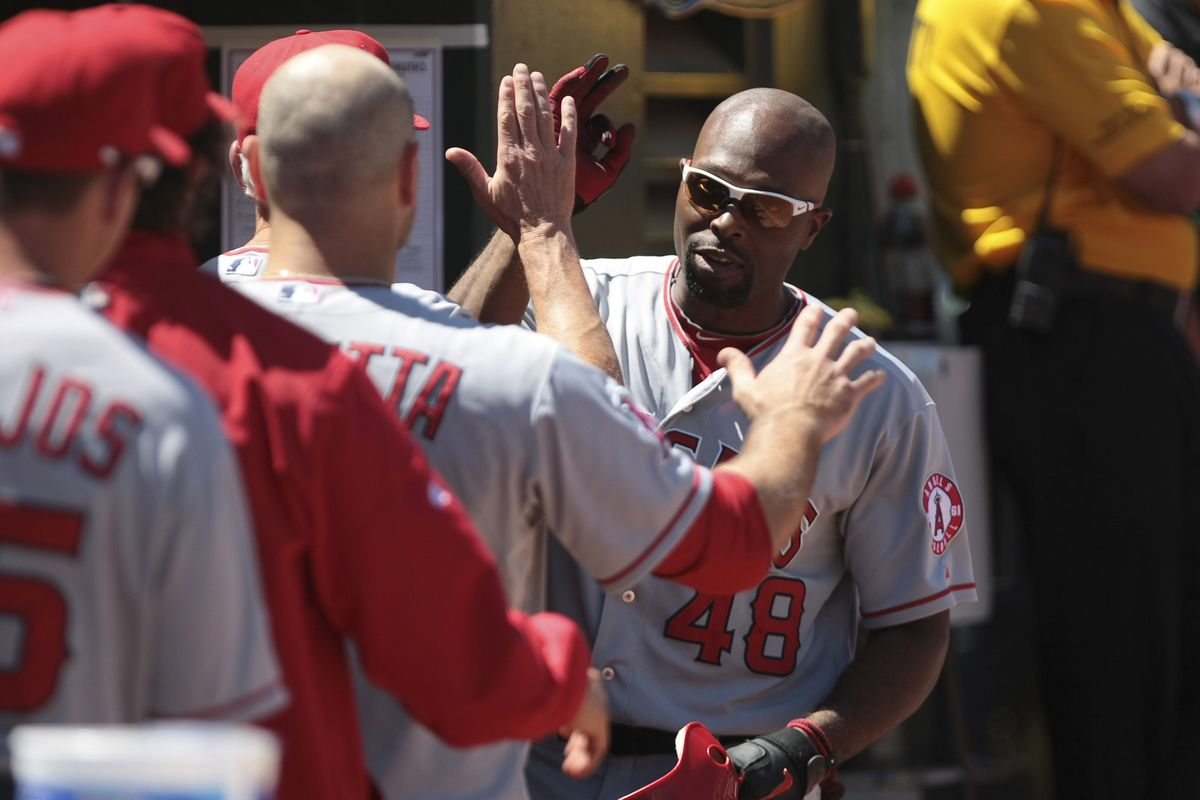 August 8, 2012; Oakland, CA, USA; Los Angeles Angels right fielder Torii Hunter (48) celebrates after hitting a solo home run against the Oakland Athletics during the fifth inning at O.co Coliseum.  Mandatory Credit: Kelley L Cox-US PRESSWIRE
