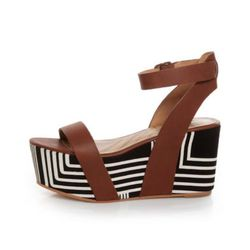 """<a href=""""http://www.lulus.com/products/matiko-lyon-brown-with-black-and-white-print-flatform-sandals/52561.html""""> Matiko Lyon black and white print platform</a>, $173 lulus.com"""
