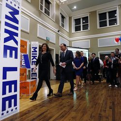 Sen. Mike Lee, R-Utah, walks with his family to the podium to claim victory in South Jordan on Tuesday, Nov. 8, 2016, in the U.S. Senate race against Misty Snow.