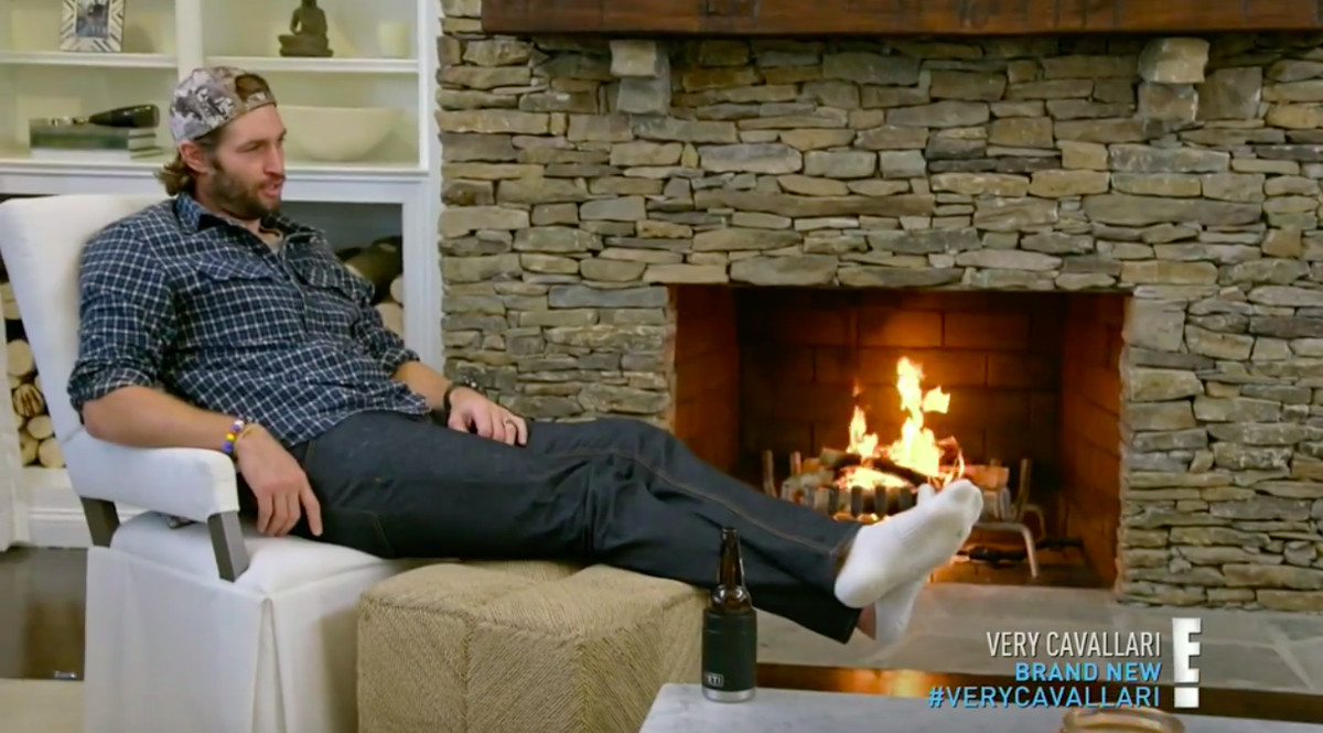 Jay Cutler sitting in front of a fireplace, with more fire this time