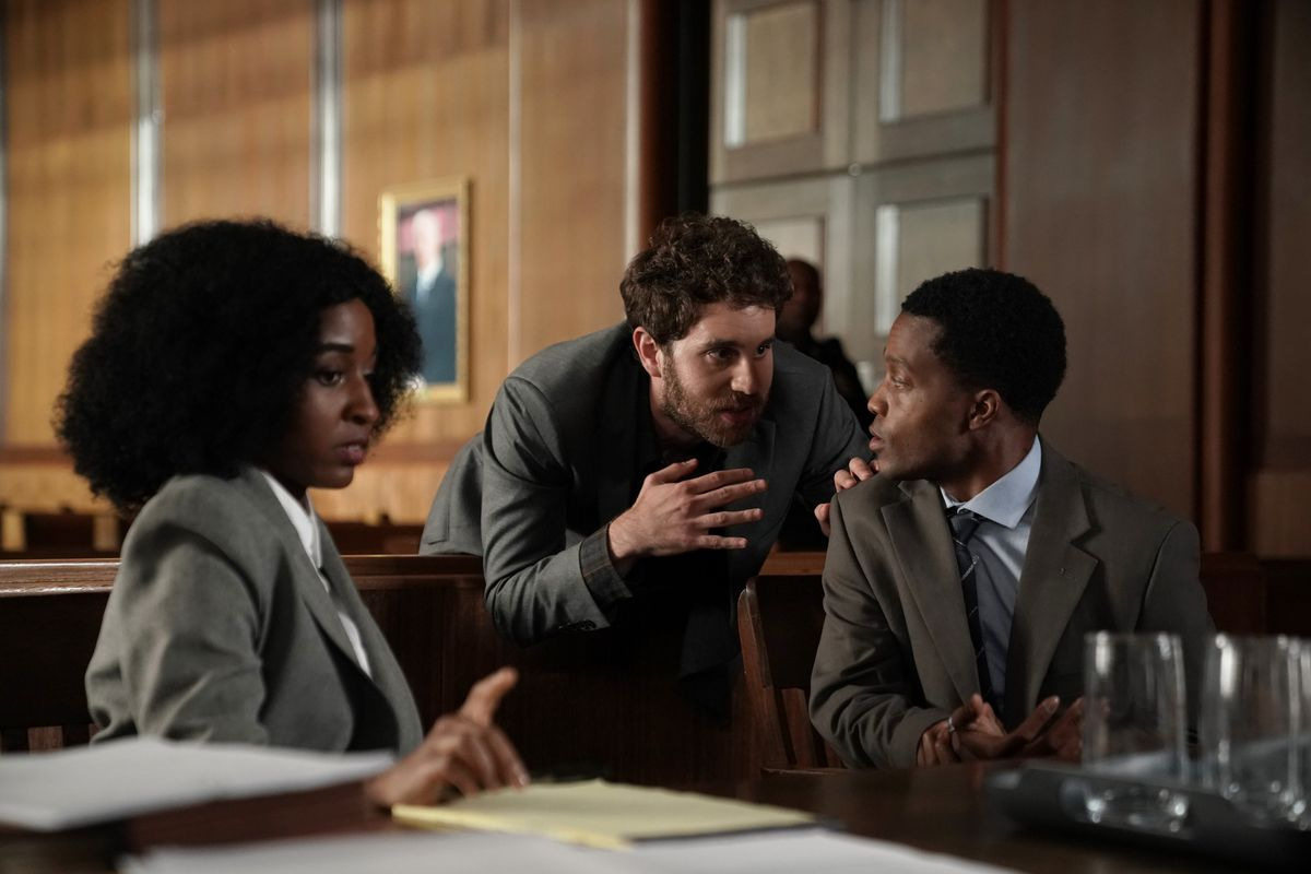 Ayo Edebiri, Ben Platt, and Jermaine Fowler huddle in a courtroom in episode 1 of FX on Hulu's The Premise.