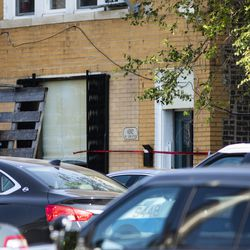 Crime scene tape could be seen outside a building after an Chicago police officer shot an alleged suspect inside an apartment in the 6200 block of West Grand Avenue, Monday morning, July 8, 2019.