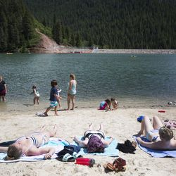 People enjoy the beach on a sunny day at Tibble Fork Reservoir on Thursday, June 15, 2017.