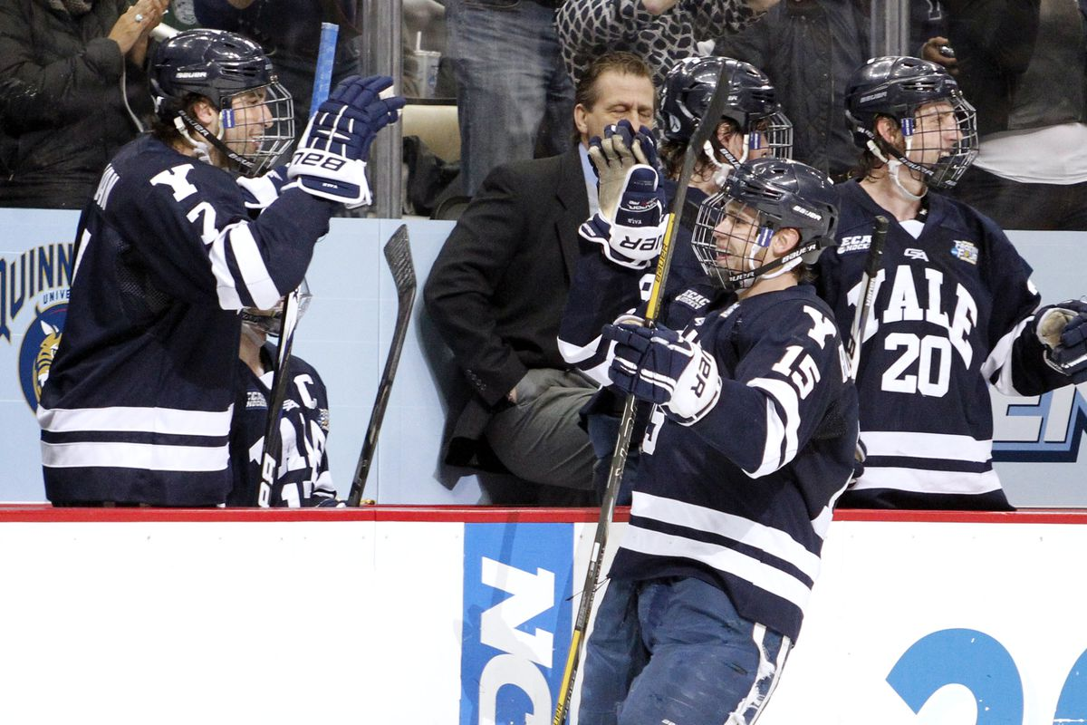 Yale players celebrate a goal during the 2013 NCAA Frozen Four.