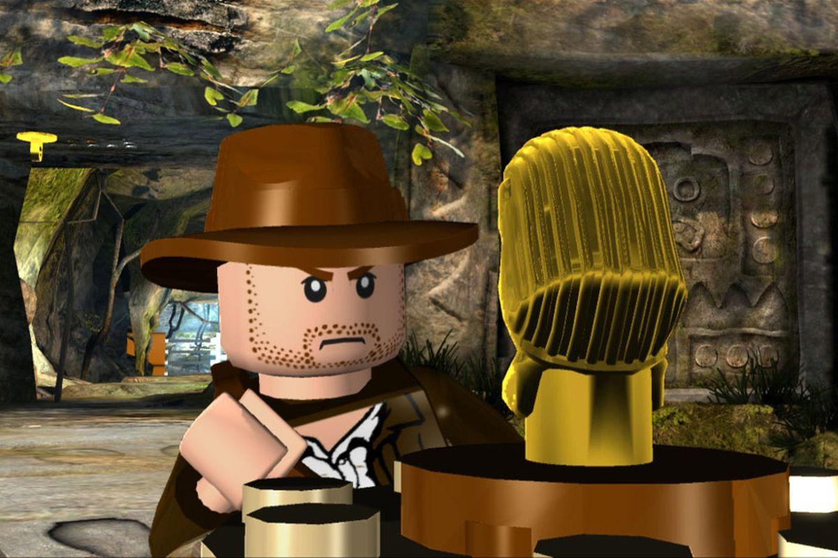 A lego-ized version of Indiana Jones examines the legoized version of the Hovitos fertility idol