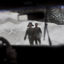 In this Monday, April 2, 2012 photo, North Korean soldiers walk on a snowy mountain road at the base of Mount Paektu, North Korea near a secret camp that is said to have been the home of the late North Korean leader Kim Il Sung and the birthplace of his son and late leader Kim Jong Il.