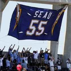 Fans react as former San Diego Chargers linebacker Junior Seau's No. 55 jersey is retired before NFL football game against the Tennessee Titans, Sunday, Sept. 16, 2012, in San Diego.