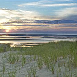 Rippling sand dunes descend across Chapin Beach and Cape Cod Bay, where fishermen have earned their living plying the waters of Nantucket Sound for centuries.
