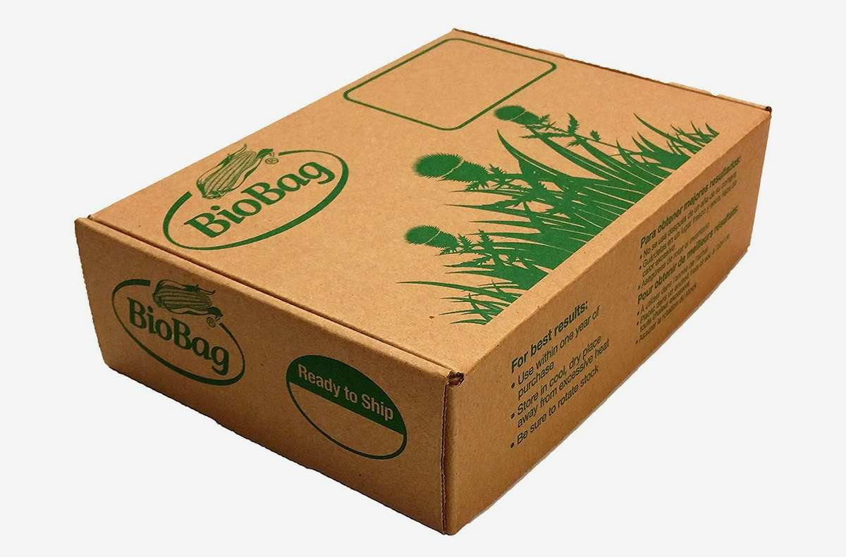 A rectangular brown cardboard box with green text printed on it.