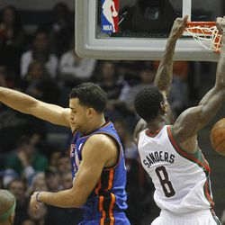Milwaukee Bucks' Larry Sanders (8) dunks as New York Knicks' Landry Fields, left, defends during the first half of an NBA basketball game on Wednesday, April 11, 2012, in Milwaukee.
