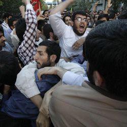 Iranian protestors chant slogans as they approach the French Embassy during a demonstration to condemn a French magazine caricaturing prophet Muhammad in Tehran, Iran, Sunday, Sept. 23, 2012.