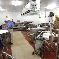 Dean Wright, director of dining services at BYU, shows the new produce production area at BYU's creamery Friday.