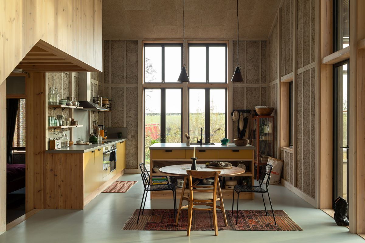 Kitchen with double-height ceiling and lots of windows