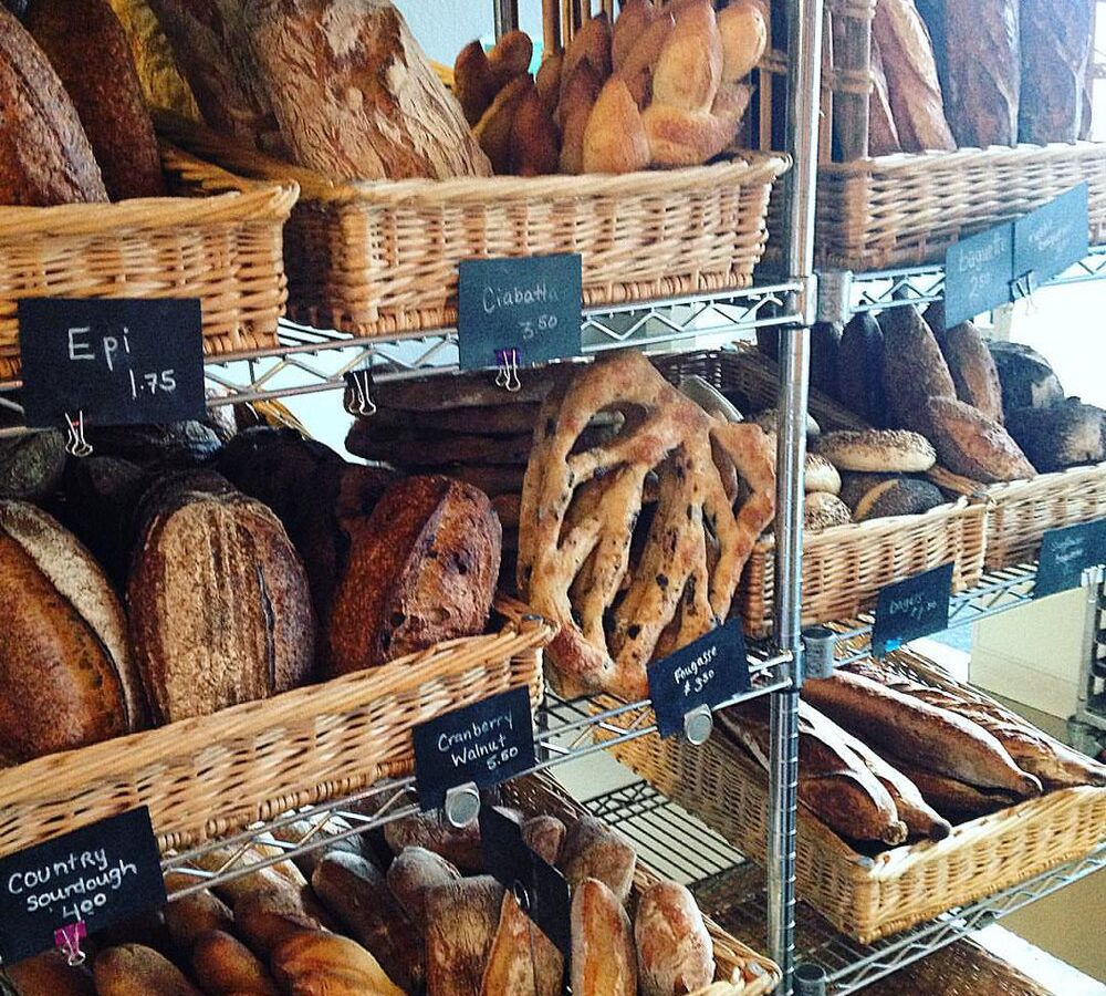 Bread in baskets at Thorough Bread and Pastry