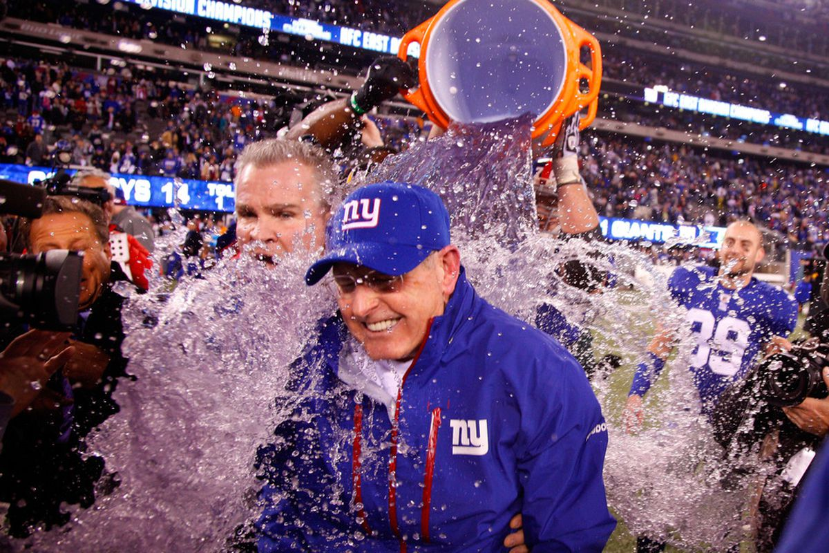 Head coach Tom Coughlin gets gatorade dumped on him after defeating the Dallas Cowboys at MetLife Stadium on January 1, 2012 in East Rutherford, New Jersey.  (Photo by Jeff Zelevansky/Getty Images)
