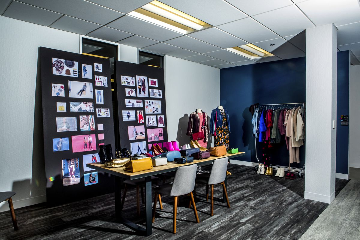 Mood boards and handbags on display in a fashion area at eBay HQ.