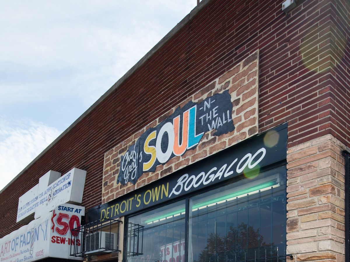 """A cropped photo of the sign for chef greg's soul in the wall that says """"Detroit's own Boogaloo"""""""