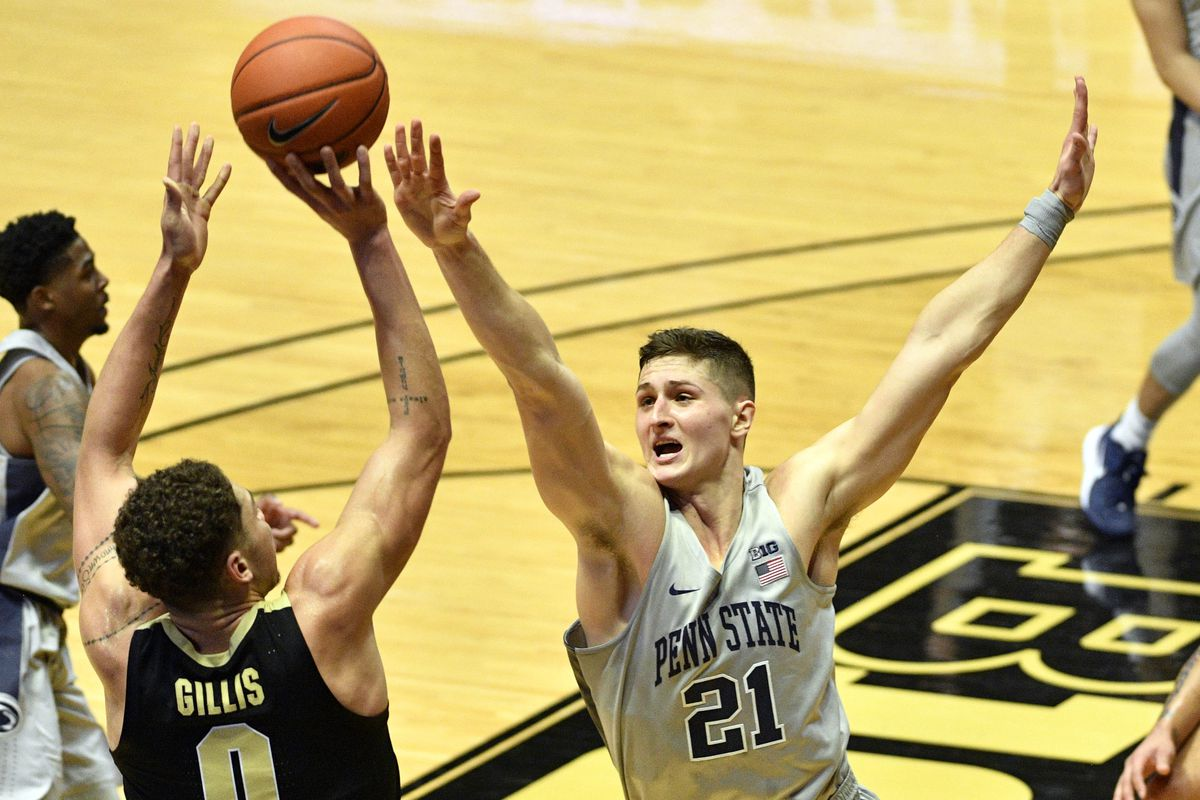 Penn State Nittany Lions forward John Harrar attempts to block a last second shot by Purdue Boilermakers forward Mason Gillis during the first half of the game at Mackey Arena.