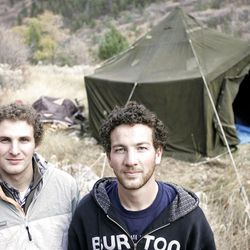 Eric Richardson, left, and Tyson Lloyd are living in the wilderness near Logan in a Vietnam-era tent in order to save extra money and avoid accruing any type of debt.