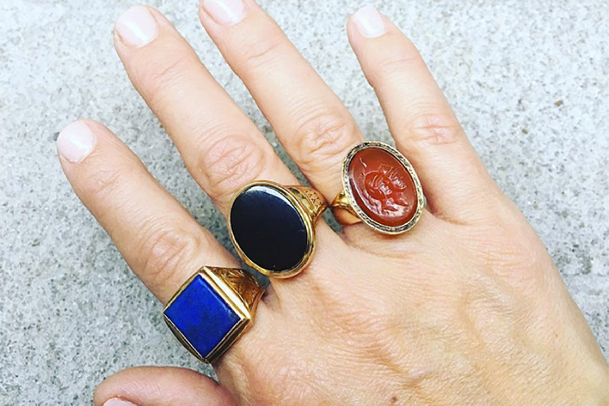 Hand with three vintage rings on fingers