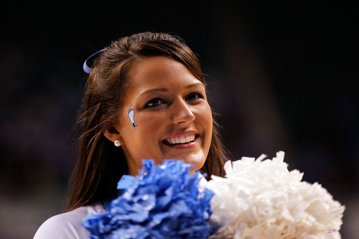 A cheerleader for the North Carolina Tar Heels performs during the 2012 NCAA Men's Basketball Tournament at Greensboro Coliseum on March 16, 2012.