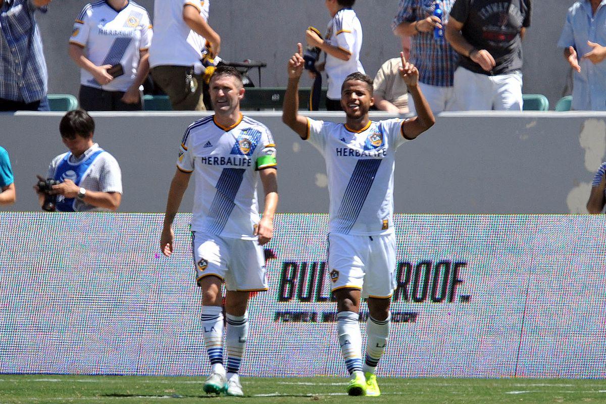 Giovani Dos Santos celebrates a goal on his MLS debut.