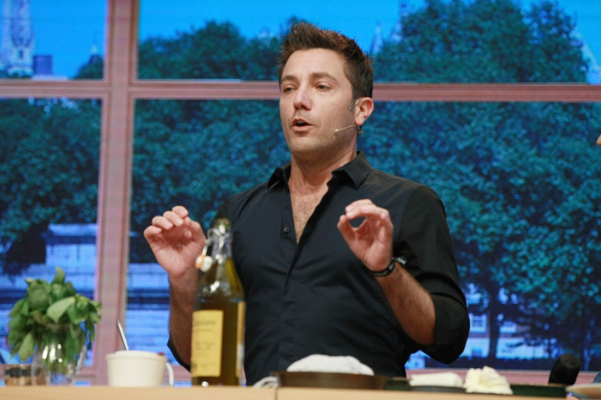 Gino DAcampo from This Morning does a cookery demonstration in Birmingham