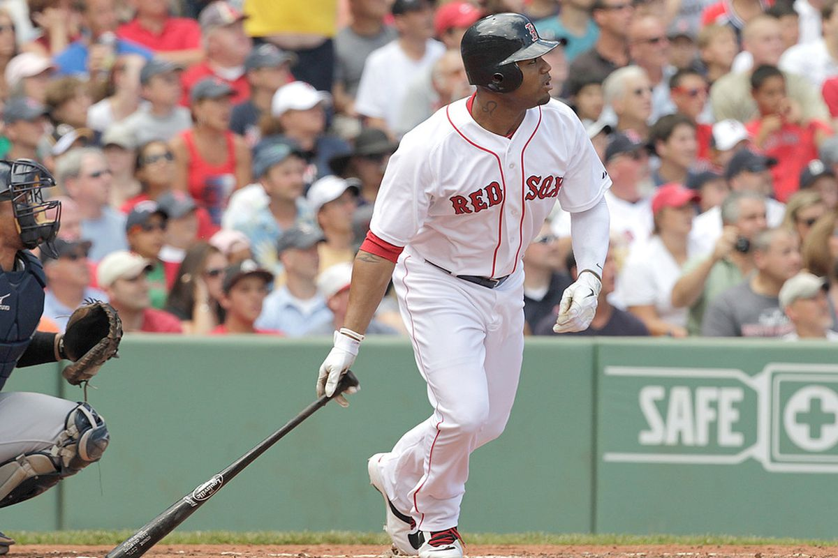 BOSTON, MA  - JULY 24:  Carl Crawford #13 of the Boston Red Sox knocks in a run with a double against Seattle Mariners at Fenway Park on July 24, 2011 in Boston, Massachusetts.  (Photo by Jim Rogash/Getty Images)