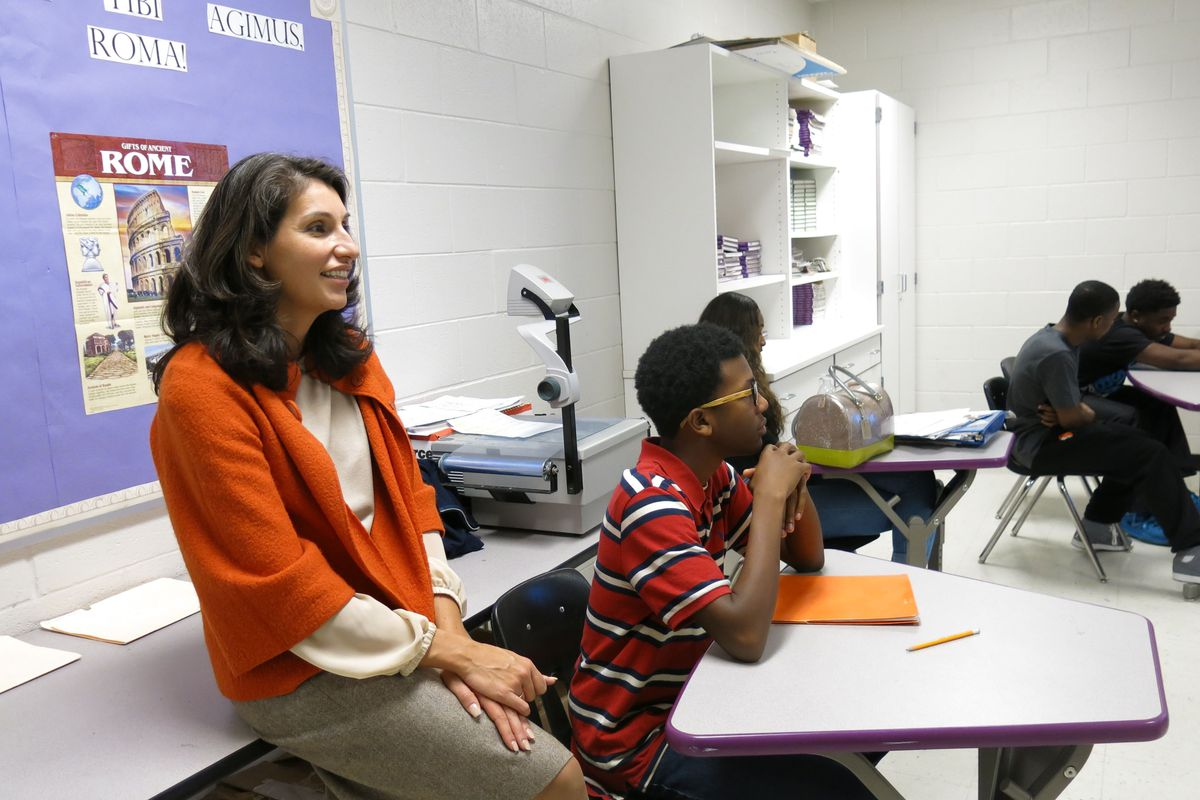 Heidi Ramirez visits a class in 2014 at Southwind High School in Memphis soon after she was named the district's chief academic officer. Ramirez announced her resignation from Shelby County Schools on Tuesday.